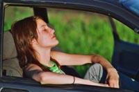 girl asleep in car