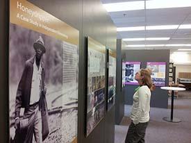 Visitors enjoy Sayles exhibit.