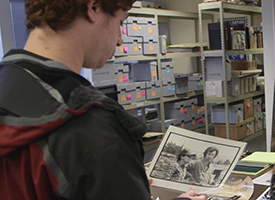 Student peruses the Sayles archives.