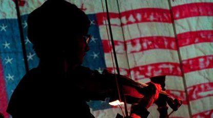 Violinist with vintage banner.