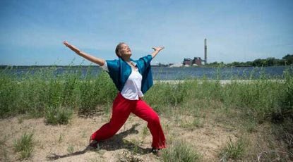 Robin Wilson dances at Lake Michigan.