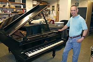 Grijalva at Gershwin piano.