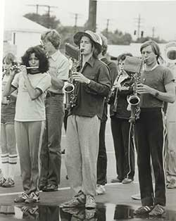 Women with men in marching band, ca 1972.