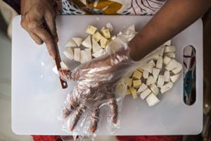 Sundara worker cuts soap.