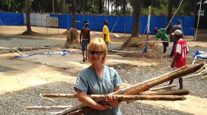 Belinda Fish gathers wood to burn Ebola units. (Courtesy of Fish.)