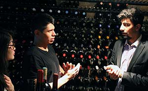 Students receive impromptu lecture in wine cellar.