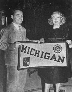 Dawson and Dietrich with Michigan banner.