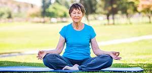 Older lady meditates, stock