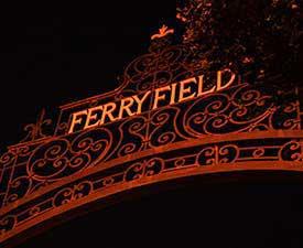 Ferry Field gate at night.