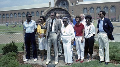 Don Canham with Minnie Owens and family at Jesse Owens plaque dedication (May 1985).
