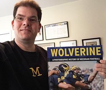 """Jon Hein with """"Wolverine"""" book."""