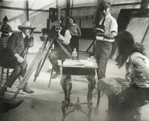 Griffith (far left) on the set of Intolerance. (Wikipedia.)
