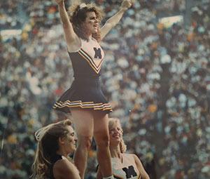 Stephanie Sladkus as Michigan cheerleader.