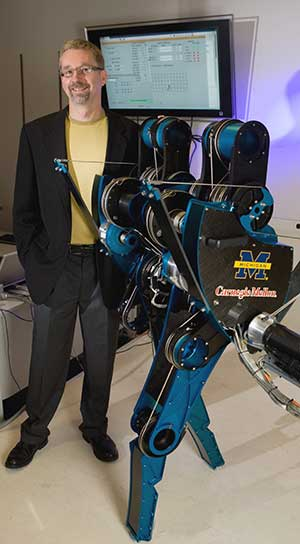 Professor of Engineering Jessy Grizzle with walking robot, MABEL. (Image credit: Martin Vloet.)