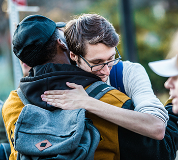 Student activists embrace, Nov. 16.