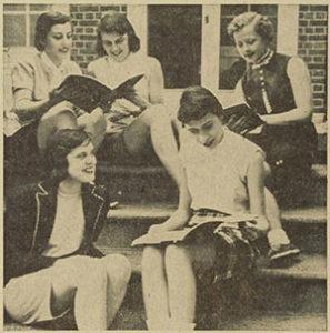 Girls wear Bermudas while studying.