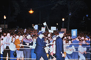 Crowds jam the streets to see JFK at the Michigan Union, 1960.