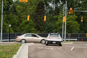 Vehicle-to-vehicle (V2V) communications help a driverless Lincoln avoid a crash