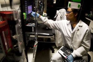 Stacy Ramcharan uses a computerized system to layer polymer fibers, forming a scaffold for growing cells into artificial tissues.