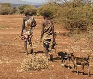 Hadza natives embark on a hunt.