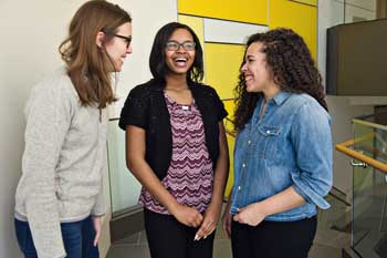 Right: Vesey shares a laugh with her mentors, medical students Semack and Jourdin Batchelor.