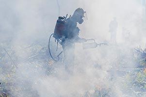Man in a cloud of smoke.