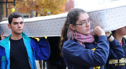 Students carry a mattress to challenge to sexual misconduct policies