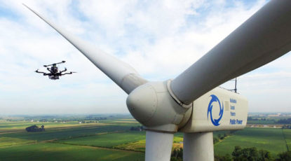 Drone inspects a wind turbine.