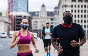 Joggers wear masks in Central London
