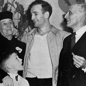 U-M football star Tom Harmon with his parents, 1940. (Image: Bentley Historical Library.)