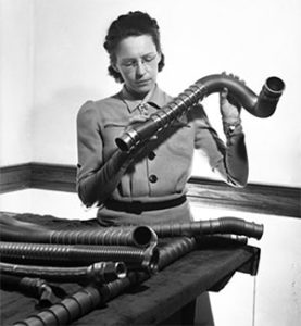 MacGill examines tubing.