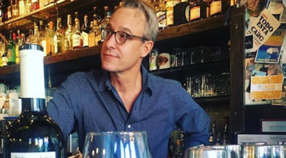 John Tebeau, author/artist/professional host behind the bar at Brooklyn's Fort Defiance. (Image: Alex Halberstadt.)
