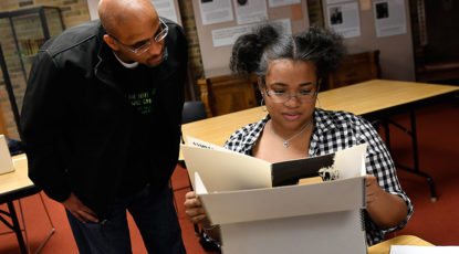 Stephen Ward, associate professor of Afroamerican and African studies, and a student examine archived materials from the Department of Afroamerican and African Studies. The materials have been newly digitized and made available online for U-M students, faculty and staff. (Image: Lon Horwedel)