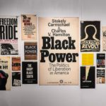 Josh MacPhee's second installation for the show, titled Black Power, 2018, is shown here. MacPhee is an artist, curator and activist living in Brooklyn, NY. He graduated from Oberlin College in 1996 and spent eight years as an artist and activist in Chicago, where he established a distribution system called justseeds in order get more radical art projects out to the public.