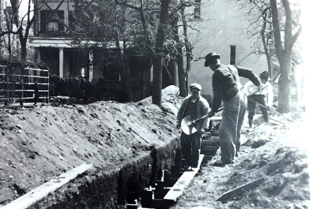 Workers dig trenches for the president's plumbing.