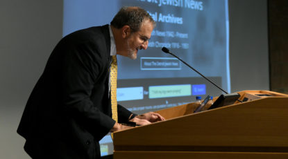 "U-M President Mark S. Schlissel conducts the first official search of the new Detroit Jewish News digital archive with the quote, ""I felt my legs were praying"" on Nov. 5, 2018. (Image: Lon Horwedel.)"
