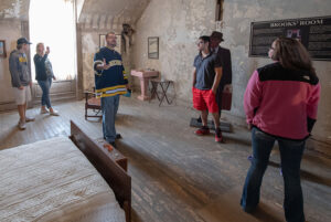 UM-Dearborn lecturer Aaron Kinzel (center) takes students to the Ohio State Reformatory.
