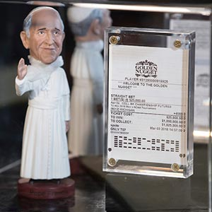 Stevens' 2018 betting slip and a figure of Pope Francis