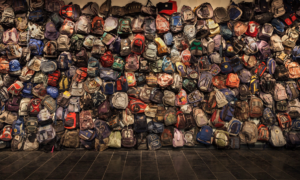 "An installation of backpacks left by migrants crossing the Sonoran Desert in Arizona debuted at the U-M Institute for the Humanities in 2013. The backpacks are exhibited in the show ""State of Exception/Estado de Excepción."" (Photo: Richard Barnes.)"
