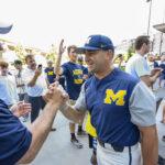 Coach Bakich shakes hands