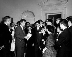 Robert Axelrod, a finalist in the Westinghouse Science Talent Search, with President John F. Kennedy in 1961. (Axelrod, with glasses, stands closest to Kennedy.) Mary Sue Coleman, who would become president of U-M, was another recipient on the same day. (Image: John F. Kennedy Presidential Library.)
