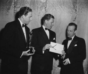 Valentine Davies and others backstage at the Oscars.
