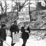 Earth Day protesters with signs, 1970