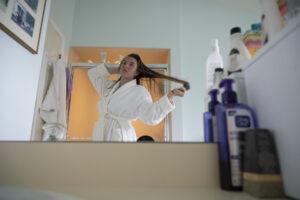 Girl brushes hair