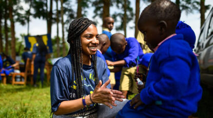 U-M student with Kenyan child.