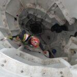 Technician inside sculpture