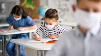 Child with mask at school