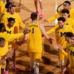 Coach Howard and Men's Basketball team, 2021 (against Rutgers)
