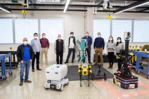 UM FMC Robotics Team with their robots. (Image Credit: Ford Motor Company.)