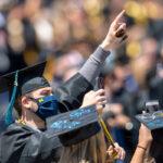 Guy celebrates graduation